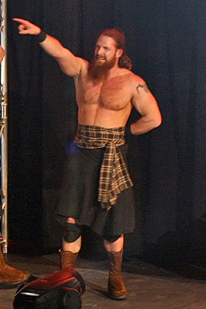 The Highlanders (professional wrestling) - Robbie signals to the crowd.