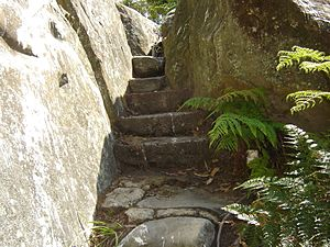 Stairs of rock to fit and placed into a natura...