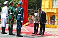 Rodrigo Duterte and Vietnamese President Tran Dai Quang bend over to show respect during a ceremony at the State Palace in Hanoi on September 29.jpg