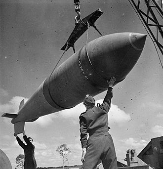 Operation Paravane - A Tallboy bomb being hoisted from a bomb dump prior to being used in a raid during 1944.