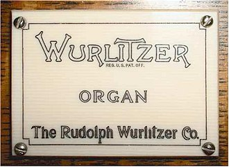 Wurlitzer - The Rudolph Wurlitzer Company logo on a pipe organ