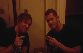 Chris Sabin and Alex Shelley posing for a picture.