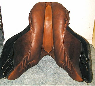 English saddle - Underside of a Dressage saddle, showing panels, gullet, sweat flaps and tips of the billets