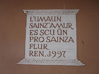 Putèr - Sgraffito on a house in Samedan, translation: A human without love is like a meadow without flowers