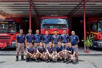 Fire and Rescue Department of Malaysia - Regular firefighters on standby taking a group photo at fire stations in Sandakan, Sabah. Photo by CEphoto, Uwe Aranas