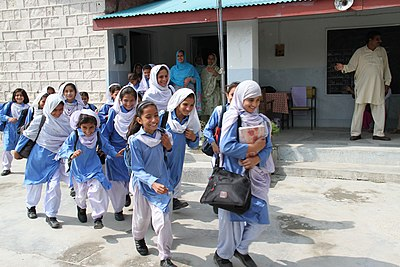 0eb2d35c070b Schoolgirls in Abbotabad, Khyber Pakhtunkhwa, Pakistan, in shalwars with  cuffed hems, and kameez with western-style collars.