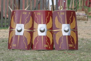 "Latins (Italic tribe) - Modern replicas of scuta (shields), as used by the legions of the Imperial Roman army. Note the alae et fulgura (""wings-and-thunderbolts"") emblem, representing Jupiter, the highest Roman god"