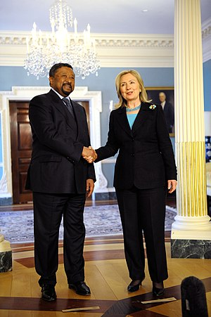 Jean Ping - Ping shaking hands with US Secretary of State Hillary Clinton in 2011