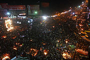 Aerial photo of large, nighttime demonstration