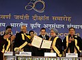 Sharad Pawar presents the Citation of the Degree of Doctor of Science (Honoris Causa) conferred on the Prime Minister, Dr. Manmohan Singh by the Indian Agricultural Research Institute.jpg