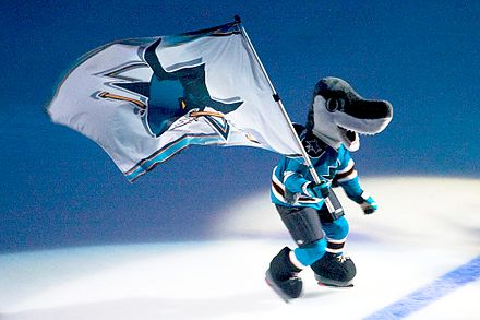 S. J. Sharkie, the Sharks' mascot, made his debut during the 1991-92 season. Sharkie with flag.jpg