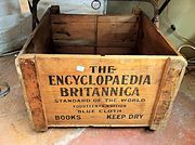 """A wooden crate reading """"THE / ENCYCLOPAEDIA / BRITANNICA / STANDARD OF THE WORLD / FOURTEENTH EDITION / BLUE CLOTH / BOOKS KEEP DRY"""""""
