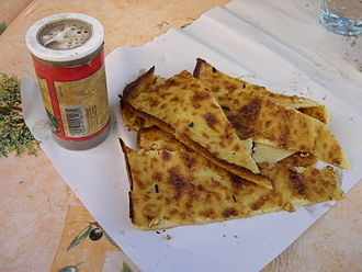Farinata - Slices of socca at a Nice market