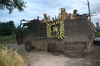 Patriot of Ukraine - Soldiers of the Azov Battalion display a flag bearing the emblem of Patriot of Ukraine.