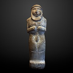 Statuette of a bearded man-AO 5719