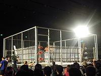 Steel cage deathmatch with 200 fluorescent light tubes - Ryuji Ito vs. Yuko Miyamoto - Big Japan Pro Wrestling - May 4, 2010.JPG
