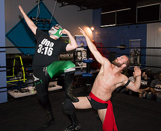Player Uno - The Super Smash Bros. - Player Uno (left in mask) and Stu Dos performing their signature in-ring pose.