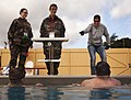 Swim Coach Sheila Taormina, a 1996 Olympic gold medalist, instructs two French Wounded Warriors during practice for the 2012 Marine Corps Trials at Marine Corps Base Camp Pendleton, Calif., Feb 120215-M-YO938-137.jpg