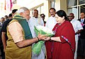 TN Governor K. Rosaiah and CM Jayalalitha receiving PM Modi at Chennai airport.jpg