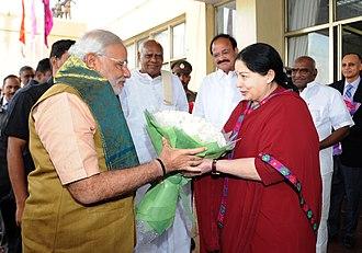 Jayalalithaa - Jayalalitha receiving Prime Minister Modi at Chennai airport