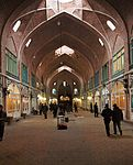 Covered arcade lined by shops.