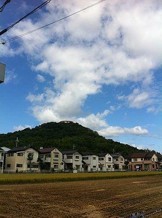 Taishi, Hyōgo - Tatsuoka Yama holds a water reservoir tank for the city of Taishi.