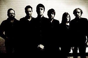 The Domino State - The Domino State. L-R; James Machin, Wil Padley, Matt Forder, Rich Simic, Carrie White, Tim Buckland.