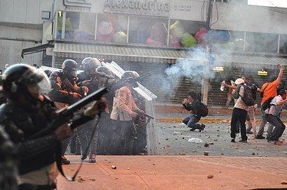 Tear gas used against protest in Altamira, Caracas; and distressed students in front of police line.jpg