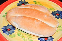 An oval-shaped loaf of bread on a plate