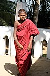 Temple novice in bright sun, Sri Lanka.jpg