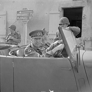 Brian Horrocks - Lieutenant General Horrocks, the newly appointed GOC XXX Corps, in his staff car with American troops in Argentan, 21 August 1944.
