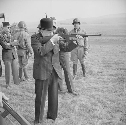 Winston Churchill fires an American M1 carbine during a visit to the US 2nd Armored Division on Salisbury Plain, 23 March 1944. The British Army in the United Kingdom 1939-45 H36961.jpg