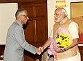 The Governor of West Bengal, Shri M. K. Narayanan calling on the Prime Minister, Shri Narendra Modi, in New Delhi on June 07, 2014.jpg