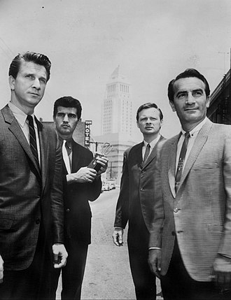 """The New Breed (TV series) - The cast from left: Leslie Nielsen as Price Adams, Greg Roman as Pete Garcia, John Clarke as Joe Huddleston, and John Beradino as Vince Cavelli, in the premiere episode, """"No Fat Cops"""" (1961)"""