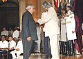 The President Dr. A.P.J Abdul Kalam presenting Padma Vibhushan Award to Justice (Retd.) Shri Manepalli Narayana Rao Venkatachaliah at an investiture Ceremony at Rashtrapati Bhawan in New Delhi on June 30, 2004.jpg