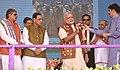 The Prime Minister, Shri Narendra Modi releasing a Bottle Pack of Banas Honey to mark its launch in the market in Palanpur, Banaskantha, Gujarat.jpg