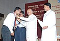 The Union Power Minister, Shri Sushilkumar Shinde giving away medal to a young engineer of NTPC at the Valedictory Programme of 2006 & 2007 Batch, in New Delhi on July 28, 2009.jpg
