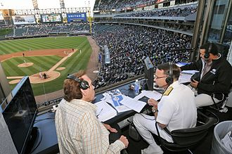 Ed Farmer - Farmer (left) in the broadcast booth in 2012.