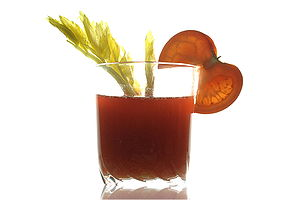 Tomato juice - Tomato Juice in a glass, decorated with tomato slice and sprig