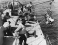 """Torpedo retriever boat recovers a Mark 24 """"Fido"""" torpedo.png"""