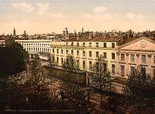 Tinted postcard of long white building