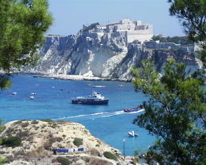 Isole Tremiti - A view of San Nicola island from the nearby San Domino island, with the Abbey of Santa Maria a Mare fortified complex.