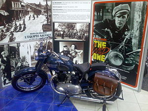 Triumph Thunderbird - Replica of Marlon Brando's mildly customised 1950 6T Triumph Thunderbird from The Wild One, surrounded by publicity stills from the film.