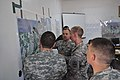 U.S. Army Lt. Col. Jay McNeil uses maps created by the National Geospatial-Intelligence Agency while acting as the brigade chief of staff for a command post exercise during a simulated civil disturbance as part 120415-D-ZZ999-038.jpg