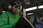 U.S. Navy Aviation Structural Mechanic 3rd Class Jodie Owrey fabricates a part in the power plant aboard the amphibious assault ship USS Bataan (LHD 5) in the Atlantic Ocean Oct. 3, 2013 131003-N-HO612-078.jpg