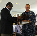U.S. Navy Capt. Kurt Hedberg, right, mission commander of Southern Partnership Station (SPS) 2010, gives Brandon Watson, regional security coordinator for Barbados, a plaque of appreciation during the closing 100826-N-EP471-439.jpg