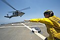 U.S. Navy Lt. j.g. Casey Strouse guides an MH-60S Seahawk helicopter attached to Helicopter Sea Combat Squadron (HSC) 9 to take off from the guided missile destroyer USS Arleigh Burke (DDG 51) in the Persian 140628-N-WD757-167.jpg