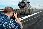 U.S. Navy Mass Communication Specialist 2nd Class Richard Gourley, foreground, captures a group photo of visiting Airmen on the flight deck of the aircraft carrier USS Ronald Reagan (CVN 76) Aug. 26, 2013 130826-N-HI324-089.jpg