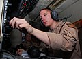 U.S. Navy Naval Aircrewman (Operator) 2nd Class David Scudder, assigned to Patrol Squadron (VP) 8, performs preflight procedures on a P-3C Orion aircraft in Bahrain Jan. 10, 2014 140110-N-CW427-009.jpg