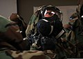 U.S. Sailors with Naval Mobile Construction Battalion (NMCB) 25 check each other's mission-oriented protective posture gear during a simulated chemical attack during chemical, biological and radiological (CBR) 140214-N-JP566-050.jpg